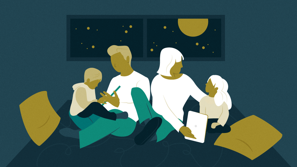 Family learning and reading together at night in a room